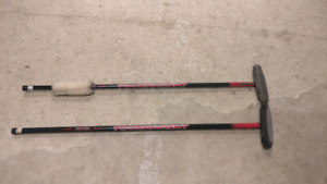 Two curling brooms