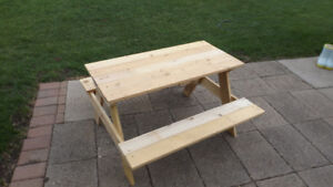 Solid wood kids picnic table measures about 36'' by 36'' by 20''