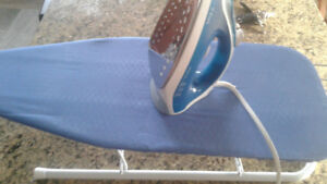 T-fal iron and table top iron board.