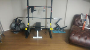 Squat stand with weights and attachments.  No low ballers.