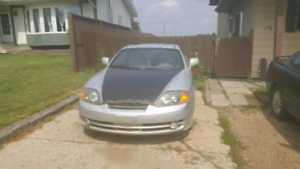 *Mechanics special* 2003 hyundai tiburon fwd 5 speed manual.