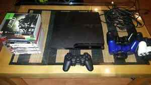 Ps3 + 11 games + 5 controllers + charging docks for controllers