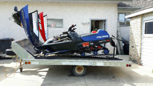 Two Polaris Indy on sled bed ready to go.