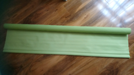 Bright green long black out blind - not used.