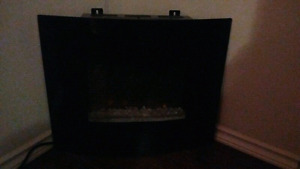 "24"" electric curved fireplace."