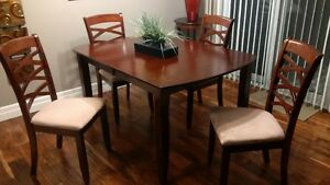 Dinner table with six upholstered chairs and Extension