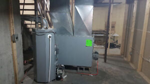 Oil fired warm air furnace and oil fired hot water tank