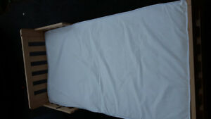 Wooden toddler bed with mattress ex condition