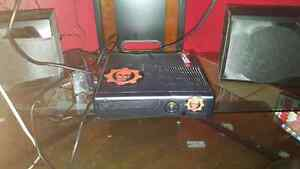 Xbox 360 slim w/ hard drive, 8 games and controller.