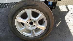 One Toyota rim and tire