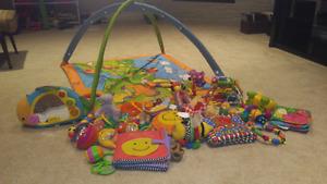 Tiny Love Baby playmatt with miscellaneous toys
