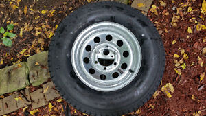 BRAND NEW TRAILER TIRE AND RIM ST225/75 D 15