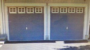 Single Insulated Standard Garage door and spare spring