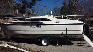 MacGregor 26M sailboat and new 50 HP 4 stroke motor with trailer