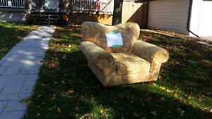 Free large chair at curb.