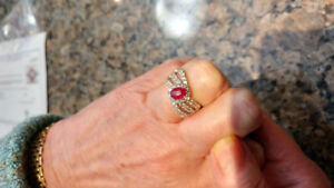 Ladies silver ring with oval natural rubies and zirconiums