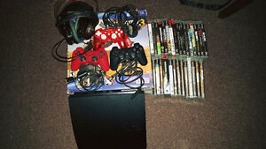 320 GB Slim Ps3 + 28 games and accessories