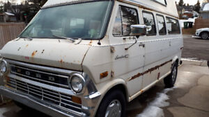 1974 Ford Econoline high-top camper for parts or restore.