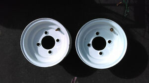 SET OF 2 NEW 8 INCH , 4 BOLT TRAILER WHEELS.