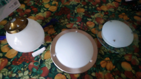 Three different ciling light shades.