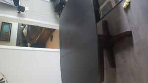 Like new dining room table and 4 chairs with leaf