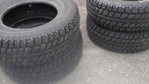265/70R17 STUDDED WINTER TIRES.EXCELLENT CONDITION