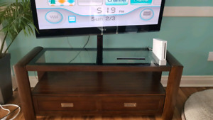 "Solid TV stand with 55"" Tv included"