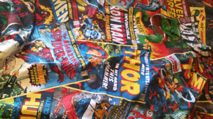 Two twin comic book duvet covers with matching pillow cases