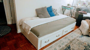 Pottery Barn twin bed with storage and mattress.
