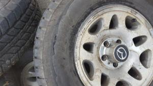 set of 4 235/75/15 winter tires
