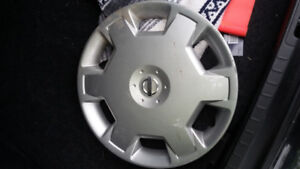 Nissan wheel cover found on side of road