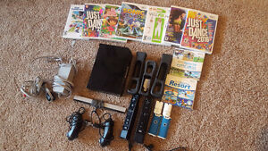 Nintendo Wii - Lots of games, controllers and nunchuks