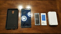 9 month old mint Samsung Note 4 with extras.