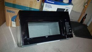 Over the range Whirlpool Microwave,