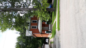 Large 2 bedroom with a den/upper half of a duplex for rent.