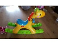 Rocking giraffe with lights and soubds