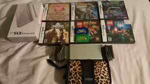 Silver Nintendo DS lite, plus 8 games