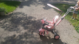 Tricycle with detachable handle