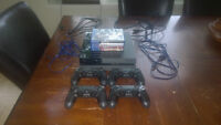 PS4 + 4 controllers + 4 games + 2 very long cable chargers