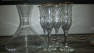 Gold rimmed wine glasses and decanter