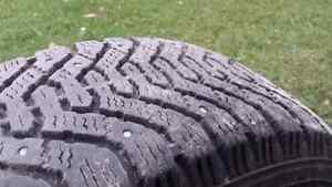 p185-65-r14 studded winter tires on rims. lots of thread left