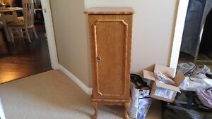 Oak coloured wood jewelry cabinet stand