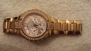Ladies Rose gold guess watch