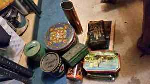 25 vintage antique tins. Some very old some newer