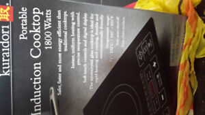 Kuradori portable induction cook top. Brand New