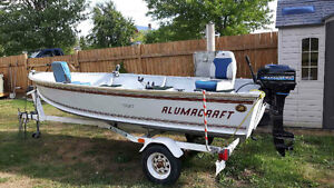 14' Alumacraft boat with motor and trailer
