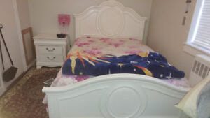 Double sized white bed