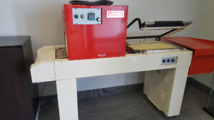 L Bar sealer with heat tunnel