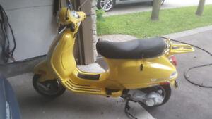 2007 vespa lx 150  ferrari yellow.    SOLD.......SOLD......