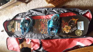 Snowboard with bindings and board bag